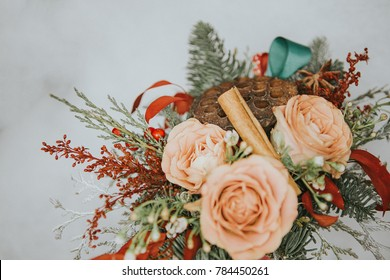 Flowers arrangement. Small roses and cinnamon sticks bouquet. Desaturated image