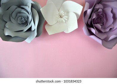 flowers background. Colourful handmade paper flowers on pink background. Vintage paper flowers. Ultra Violet, Grey, flowers paper background pattern lovely style. Rose made from paper. Happy womans da