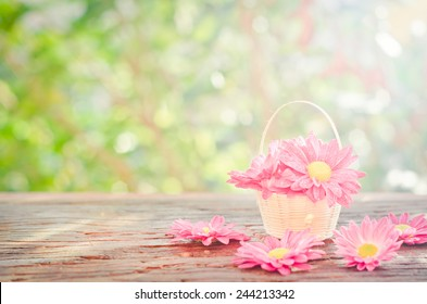 Flowers in a basket  on a wooden with bokeh background in a vintage retro style, with the sunrise, for the day of love, Valentine's Day.
