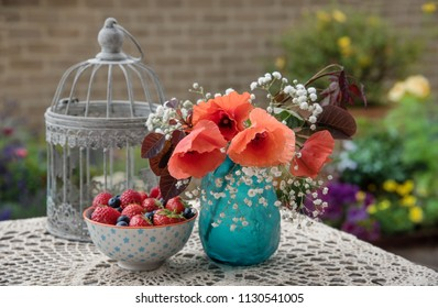 Flowers and berries on the table, outdoor table decor, in the garden