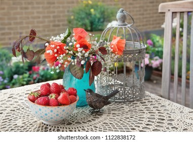 Flowers and berries, outdoor summer table decor, in the garden