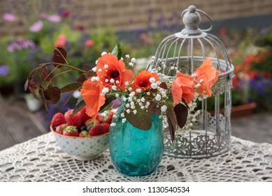 Flowers and berries, outdoor table decor, in the garden