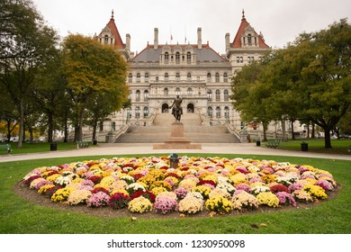Flowers bloom in multiple colors on the lawn in front of the New York statehouse in Albany