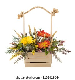 Flowers bouquet arrangement in pine basket isolated on white background.