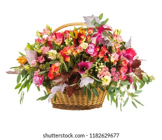 Flowers bouquet arrangement in wicker basket isolated on white background.  Closeup.