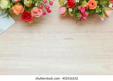 Flowers bouquet shoot soft focus arrange for decoration on wood background.With copy space.