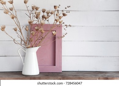 flowers bouquet,empty board on shelf in front of  wall.Shabby old interior decor for farmhouse. Home decoration.