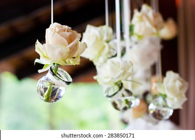 Flowers in bulbs hang in a wedding party