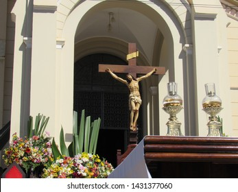 Flowers, candles and crucifix. Christ's Body Holiday