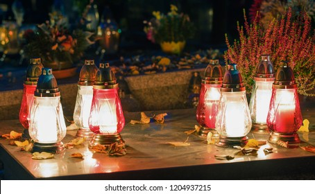 Flowers, candles, lights on the graves and tombs. Colorful polish cemetery in the autumn. All Saints' Day.