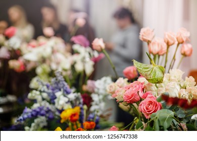 Flowers composition. Abstract background of flowers. Female florist making beautiful bouquet at flower shop. Close-up.