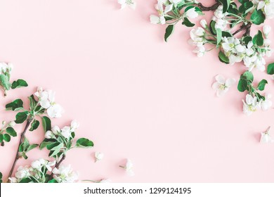 Flowers composition. Apple tree flowers on pastel pink background. Spring concept. Flat lay, top view, copy space
