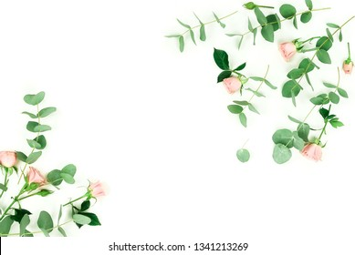 Flowers composition background. pink  roses and eucalyptus leaves branches on white background top view.  Copy space