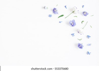 Flowers composition. Border made of lilac and white flowers. Flat lay, top view, copy space