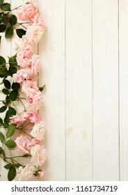 Flowers composition. Bouquet of beautiful pale pink roses on white wooden background.Top view.Copy space