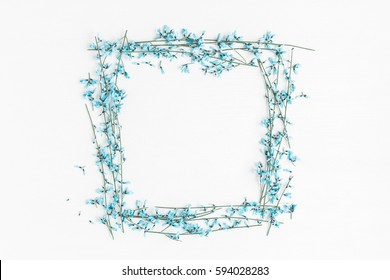 Flowers composition. Frame made of blue flowers on white background. Easter, spring concept. Flat lay, top view, copy space