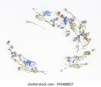 Flowers composition. Frame made of dried flowers on white background. Flat lay, top view.
