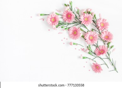 Flowers composition. Frame made of pink flowers on white background. Valentine's Day background. Flat lay, top view, copy space.