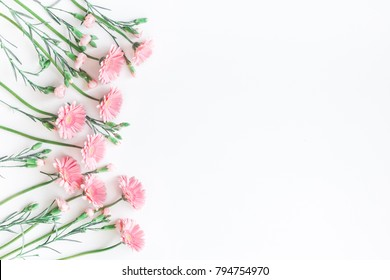 Flowers composition. Frame made of pink flowers on white background. Flat lay, top view, copy space.