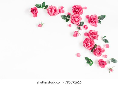 Flowers composition. Frame made of pink rose flowers on white background. Flat lay, top view, copy space.