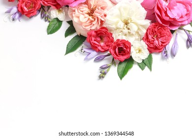 Flowers composition. Frame made of rose flowers on white background. festive background, pastel and soft bouquet floral card. Flat lay, top view, copy space