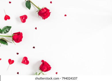 Flowers composition. Frame made of rose flowers, confetti on white background. Valentine's Day background. Flat lay, top view, copy space.
