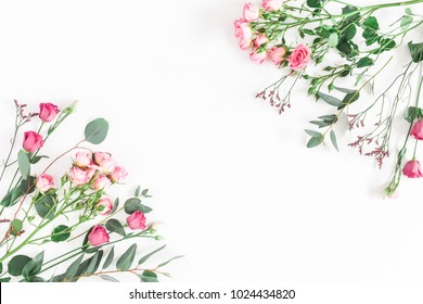 Flowers composition. Frame made of various pink flowers and eucalyptus branches on white background. Flat lay, top view, copy space