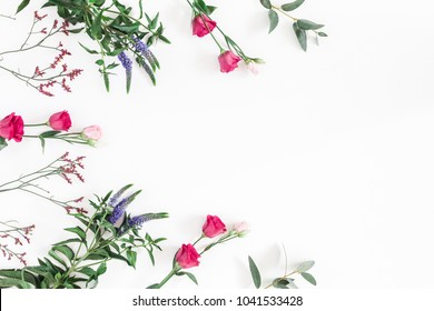 Flowers composition. Frame made of various colorful flowers on white background. Flat lay, top view, copy space