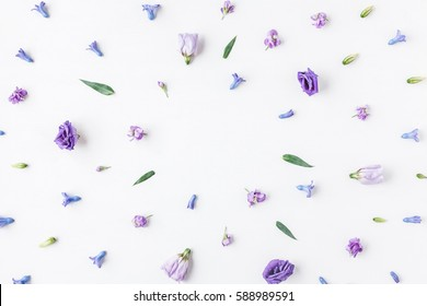 Flowers composition. Frame made of various colorful flowers on white background. Flat lay, top view
