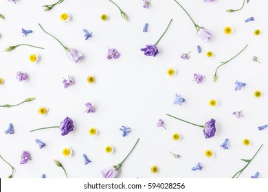 Flowers composition. Frame made of various colorful flowers on white background. Easter, spring, summer concept. Flat lay, top view.