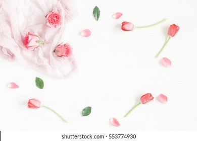 Flowers composition. Frame with rose flowers and tulip on white background. Easter, spring concept. Flat lay, top view.