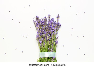 Flowers composition. Fresh bouquet of purple lavender with festive ribbon on light gray background. Flat lay top view copy space. Lavender, floral background, flower card. Minimal concept.