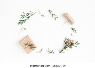 Flowers composition. Gifts, pink flowers and eucalyptus branches on white background. Flat lay, top view