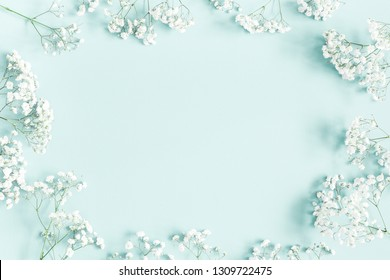 Flowers composition. Gypsophila flowers on pastel blue background. Flat lay, top view, copy space