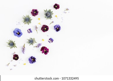 Flowers composition. Pattern made of colorful flowers on gray background. Flat lay, top view, copy space