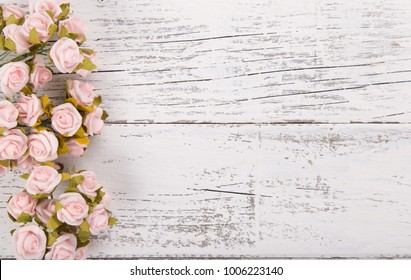 Flowers composition for Valentine's, Mother's or Women's Day. Pink flowers on old white wooden background. Still-life.