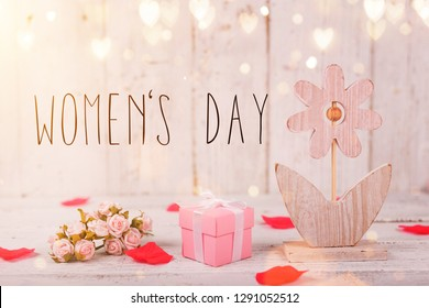 Flowers composition for Women's Day. Pink flowers on old white wooden background. Still-life.