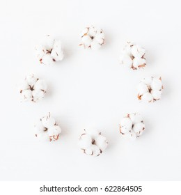 Flowers composition. Wreath made of cotton flowers on white background. Flat lay, top view.