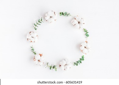 Flowers composition. Wreath made of fresh eucalyptus branches and cotton flowers. Flat lay, top view, copy space