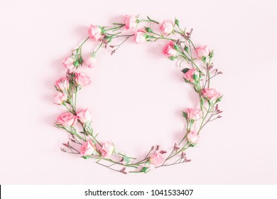 Flowers composition. Wreath made of pink rose flowers on pink background. Flat lay, top view, copy space