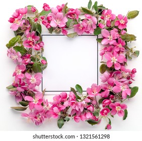 Flowers composition. Wreath made of pink flowers with card