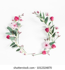 Flowers composition. Wreath made of various pink flowers and eucalyptus branches on white background. Flat lay, top view, copy space, square.