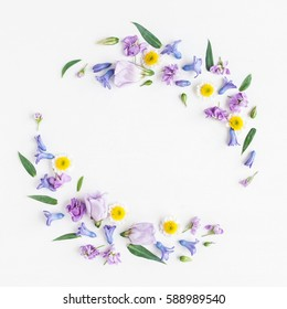 Flowers composition. Wreath made of various colorful flowers on white background. Easter, spring, summer concept. Flat lay, top view