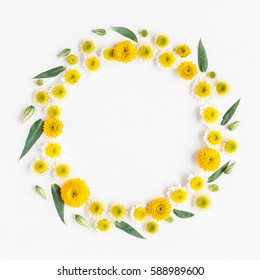 Flowers composition. Wreath made of various yellow flowers on white background. Spring, summer, easter concept. Flat lay, top view, copy space