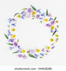 Flowers composition. Wreath made of various colorful flowers on white background. Easter, spring, summer concept. Flat lay, top view.