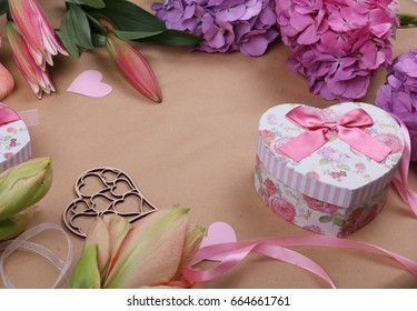 Flowers and decor in pink colors place for text