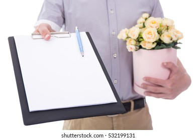 flowers delivery - flowers and blank clipboard in male hands isolated on white background