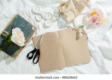 flowers with empty vintage notebook for your design