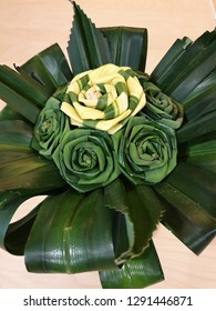 Flowers folded from the leaves of pandans is a handcraft.Roses bouquet from folded pandan leaves. Handmade flower made from pandan leaves. Close up of roses made by oandan leaves.