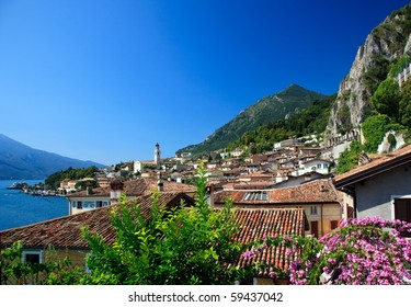 Flowers frame the rooftops of Limone on Lake Garda Italy